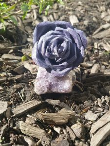 Handcrafted rose on raw amethyst
